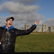 Student standing in front of Stonehenge in England